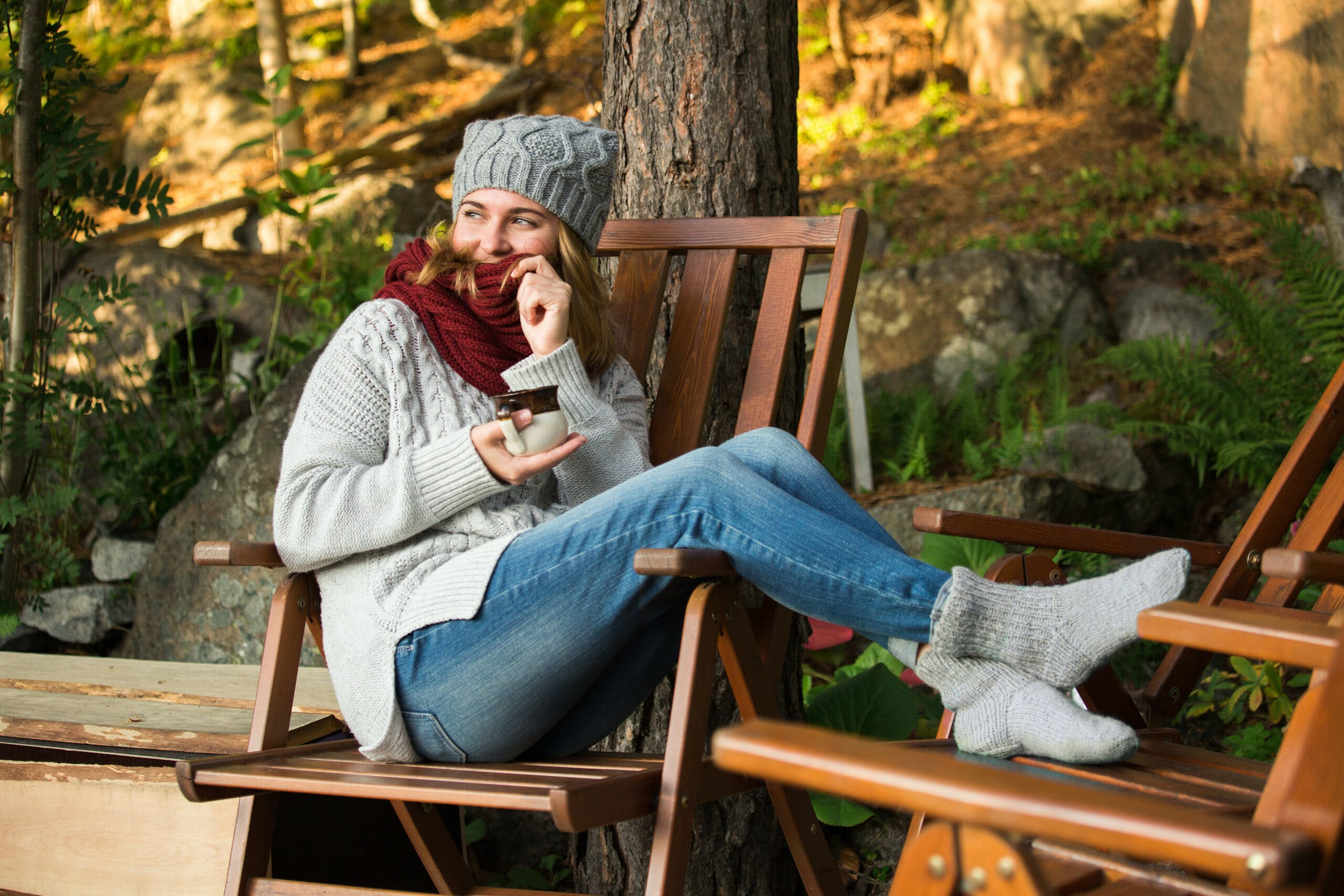 Woman In A Knitted Sweater And A Knitted Hat Sits: Stay in scandinavia for a city holiday